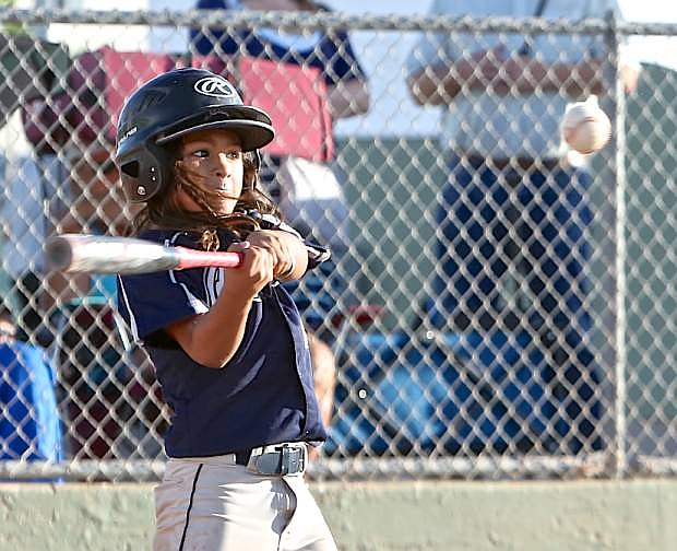 10-year-old All-Star Radley Felix tees off on a pitch that would be good for a single Friday night at Governor's Field.