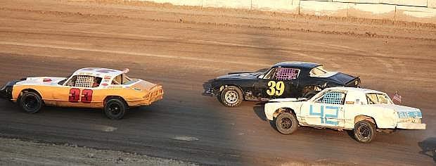 Tami Buen, 33, Royce Goetz and Ray Miller roar down the back straightaway on Rattlesnake Raceway's track.