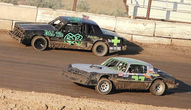 Dave Ausano, 63, and Bob Shank, 37, skid into a turn at Rattlesnake Raceway.