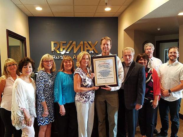 Carson City RE/MAX team proudly displays their Brokerage of the Year Award for 2016, recieved in April.