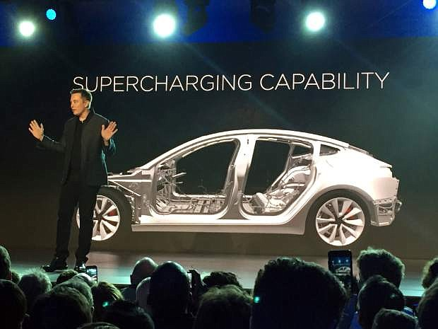 FILE - In this March 31, 2016, file photo, Tesla Motors Inc. CEO Elon Musk speaks at the unveiling of the Model 3 at the Tesla Motors design studio in Hawthorne, Calif. Electric car maker Tesla said on Monday, July 3, 2017, that its Model 3 car will go on sale on Friday. (AP Photo/Justin Pritchard, File)