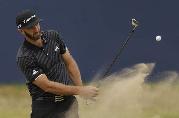 Dustin Johnson of the United States plays out of the bunker on the 18th hole during a practice round Wednesday ahead of the British Open at Royal Birkdale, Southport, England.