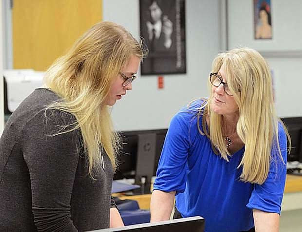 Western Nevada College graphics communications Instructor Jayna Conkey works with student Megan Lynch, of Carson City, in class on May 16, 2016.