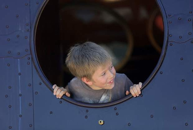 Tucker Thompson, 8, looks out the window of the McKeen Motor Car while taking a train ride at the Nevada State Railroad Museum on Monday afternoon.