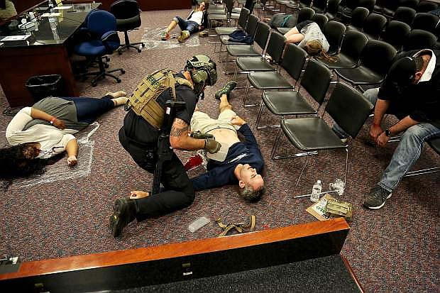 Carson City Fire Department SWAT paramedic Jon Pedrini tends to a victim during a training.