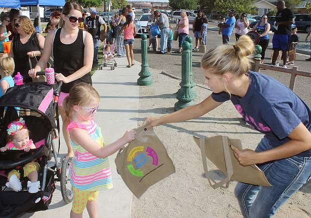 A child accepts a gift bag from a Community Day representative during last year's festivities.