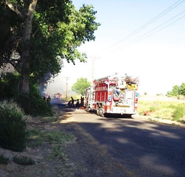 Fallon firefighters respond to a fire on Reservoir Road on Monday.
