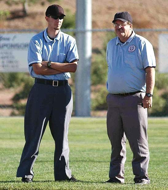 Father and son: Thomas, left, and Steve Ranson stand in the field during a state Cal Ripken youth baseball game in 2006.