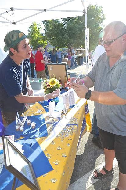 Adrian Morales of Bleu Cafe serves Bob Shouppe Saturday evening.
