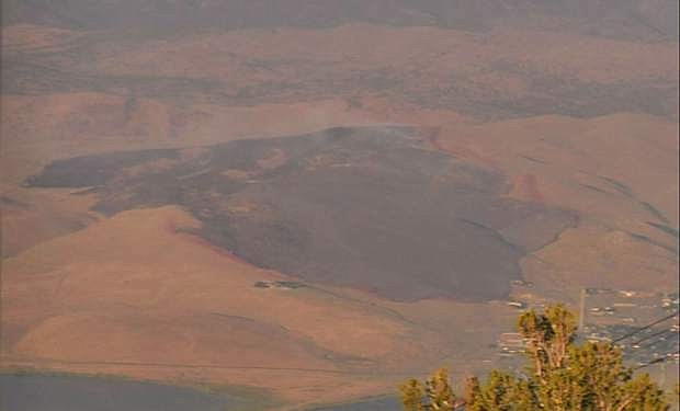 The burn scar of the Brenda Fire is seen Friday evening from the fire camera on Slide Mountain.