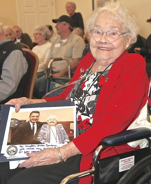 Phyllis Bendure beams as she sits with her photo with Gov. Sandoval at the State of the State last week.
