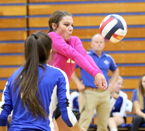Carson High School's Abbey Paulson bumps the ball to the front line in a match against Reno on Tuesday night.