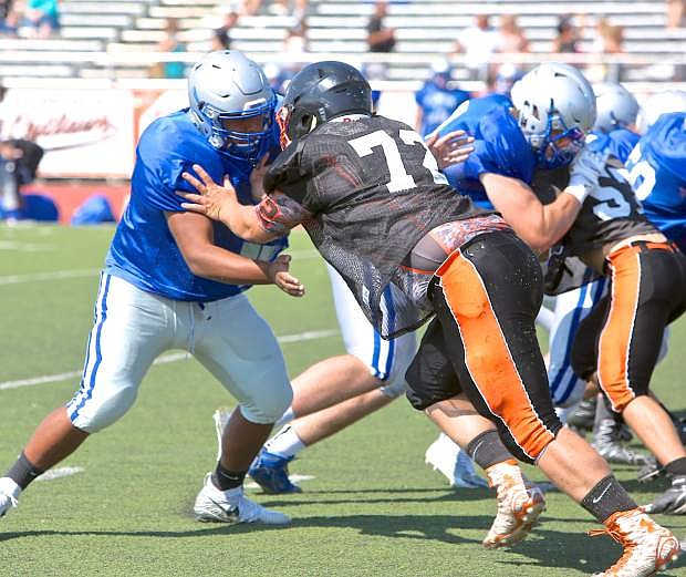Defensive tackle Austin Aiken (72) battles with a McQueen player Saturday at Douglas High.