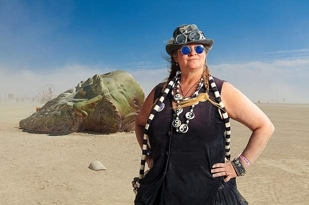 Sculptor MiscHell Riley at Burning Man 2016 with her sculpture Inside the Mind of daVinci. Photograped on August 30, 2016 by Scott R. Kline at Black Rock City, NV.