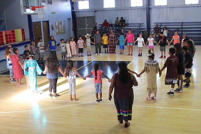 Loni Romo, who taught students the dances, watches over and explains to the community what the dances mean.