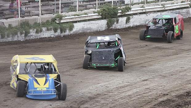 From left, James Riggs, Vincent Evenson and Jay Bradley roar around the first bend during their heat race.