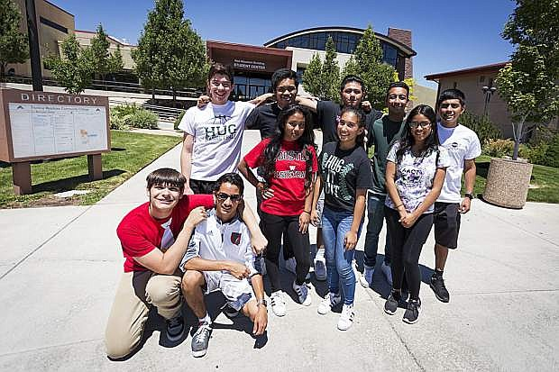 A group of Truckee Meadows Community College students pose in front of the campus. TMCC is one of four Nevada community colleges that will benefit from the Nevada Promise Program.