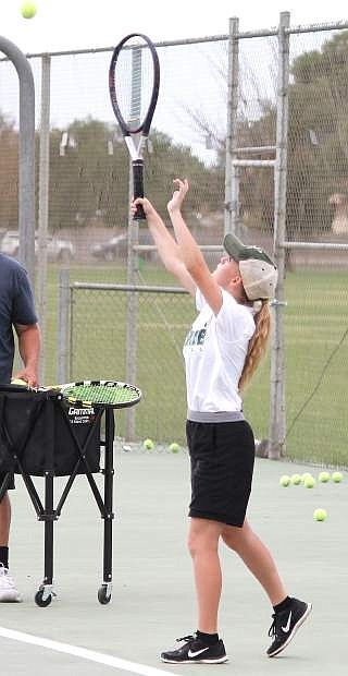 Abigail Ritts practices her serve during a tennis team practice.