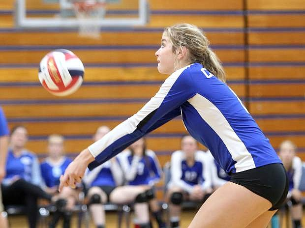 Stefanie Schmidt bumps the ball to the front line in a game against Hug on Tuesday.