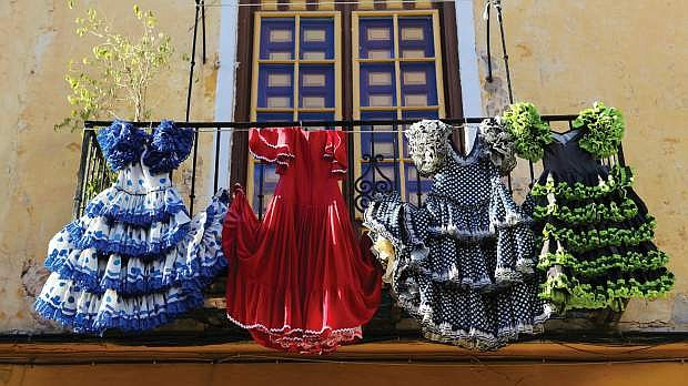 After a night of dancing, dresses are washed and hung to dry in Spain.