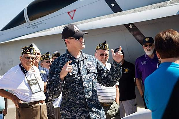 Navy Mass Communication Specialist First Class Joe Vincent leads members of The American Legion National Security Commission during a tour of the facilities at Naval Air Station Fallon.