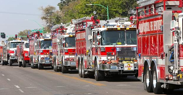 Fire trucks make their way down the parade route on Monday.