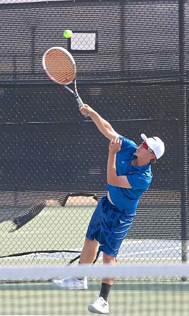 Carson's Jared Barnard serves to his North Valleys opponent Thursday at CHS.