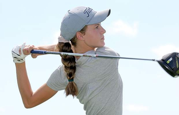 Karen Beglin eyes her tee shot on the sixth hole at Eagle Valley Golf Course on Tuesday.