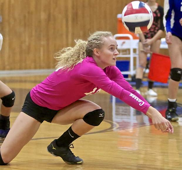 Abby Pradere digs a Wooster serve Wednesday night at CHS.