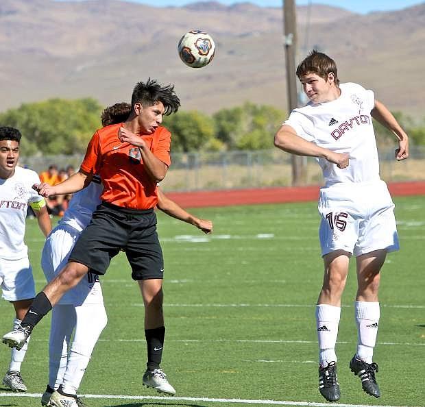 Dayton's Nicholas Reul battles with a Fernley player Wednesday at Dayton High School.