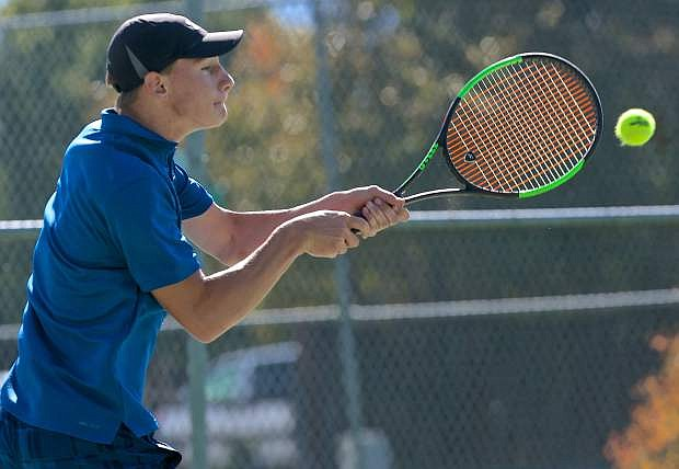 Senator number one singles player Will breeding returns a serve against his Douglas opponent Thursday at Lampe Park.