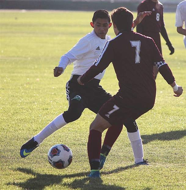 Bryan Ugalde spars with Elko's player Saturday morning.