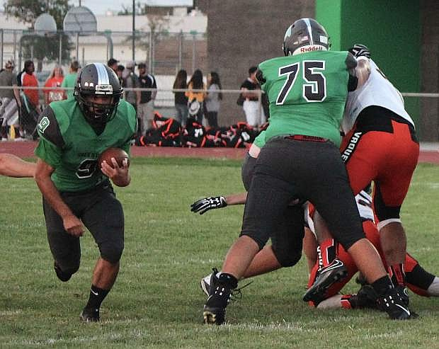 Reid Clyburn, left, races down the field as Nick Delgado holds off Fernley's defense.