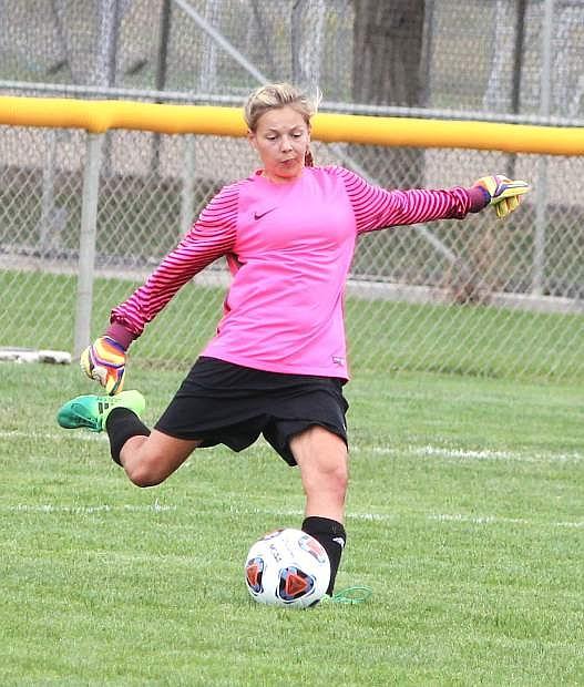 Samantha Hines kicks the ball back into play at the CCHS field.
