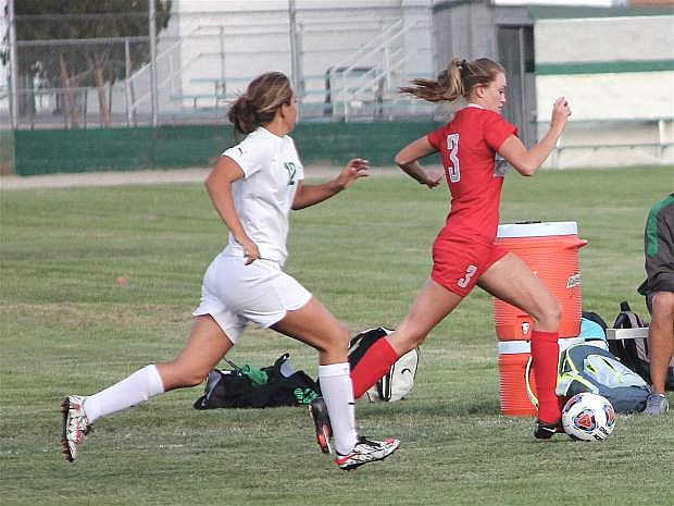 Mayla Dahl, left, races to get the ball from Truckee's Liliana Hosefros.