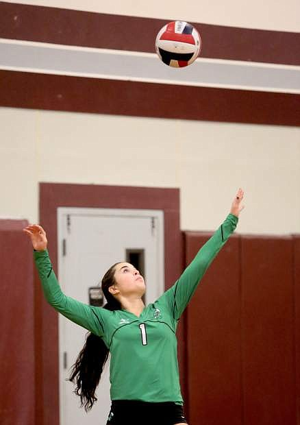 Taylor Ingram serves the ball in a match against Dayton on Monday.
