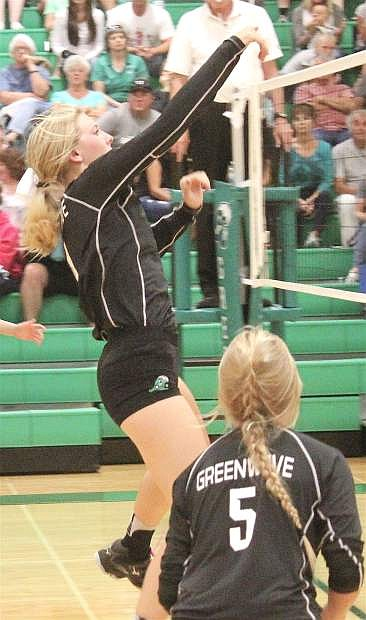 Karlee Hitchcock slams the ball over the net during the Lady Wave's match against Spring Creek.