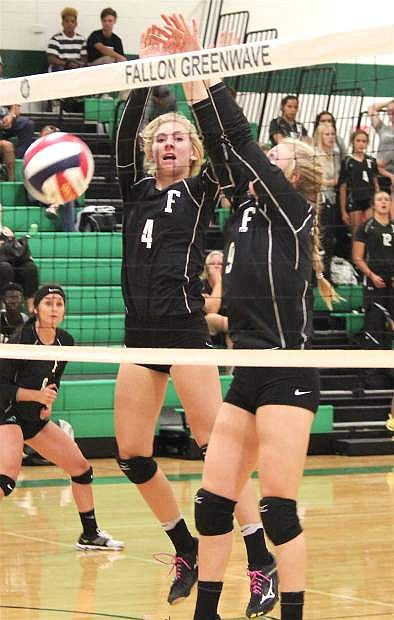 Jordan Byer, left and Karlee Hitchcock block the ball at the net during Fallon's match against Lowry.