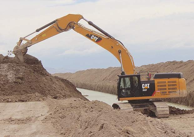 """An excavator works on the final stretch of """"The Big Dig"""" east of Fallon in May."""
