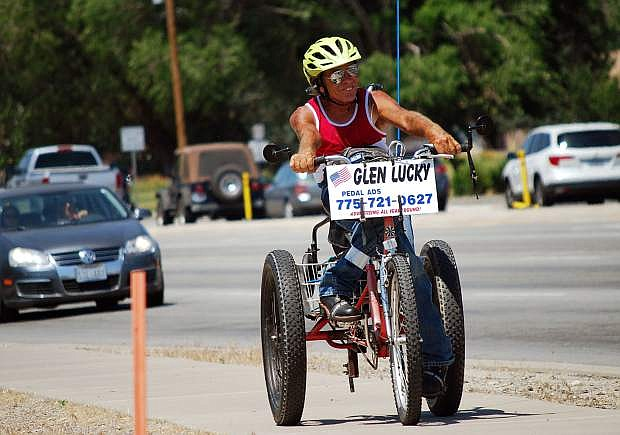 Glen Lucky rides his tricycle near the intersection of Fairview Drive and Carson Street on Monday, July 3, 2017. Guy Clifton/Travel Nevada