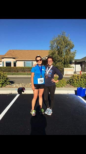 Avery Hudak, left, won the Carson City Kiwanis Club's Pancreatic Cancer Awareness Day 5K last year and will return for this year's event Saturday. The event raises money for the Pancreatic Cancer Action Network and a local scholarship.
