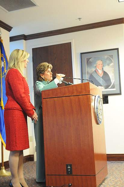 Attorney Gloria Allred makes the case to ensure the parole board considers domestic battery convictions in decidingwhether to release an inmate while Nevada Assemblywoman Lisa Krasner, who is sponsoring the legislation, looks on. The bill was drafted in the wake of the board decision to parole O.J. Simpson, who was charged with domestic battery in 1989.