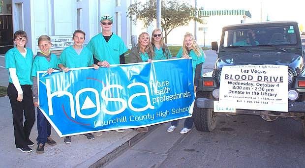 Churchill County High School is having a Las Vegas blood drive today from 8 a.m.-2:30 p.m. in the library. Presently, the number of appointment slots has been increased to between 30-40 and is open to the community. Call 800-696-4484. From left HOSA members Amanda Olsen, Will Swisher, Hunter Cooper, Shaw Lee, Kenzi Bernard, Olivia Parkerson and Karlee Hitchcock. In the vehicle are Jace Harmon and Chase Irvin.