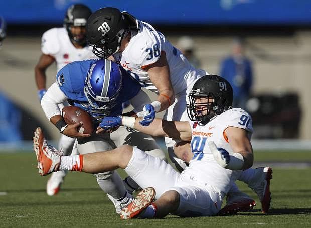 Air Force quarterback Arion Worthman, left, shown running against Boise State on Nov. 25.