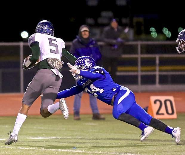 Abel Carter stretches to bring down a Damonte receiver Friday night at CHS.