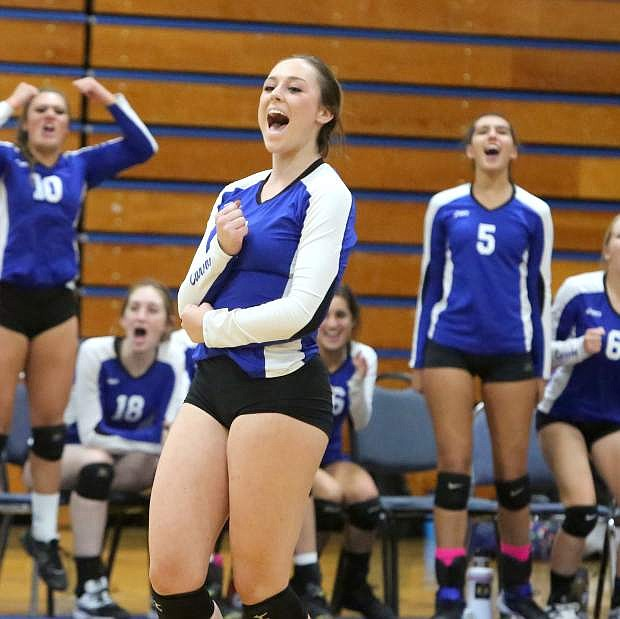 Natalie Anderson celebrates a win over Galena on Tuesday night.