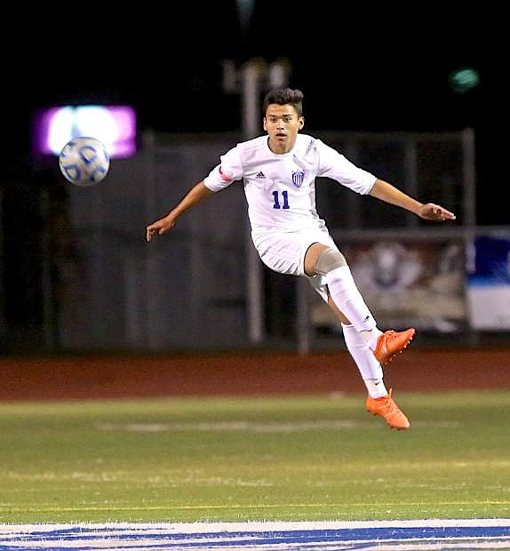 Efren Ramirez boots the ball downfield against Wooster Wednesday night at the Jim Frank Track and Field Complex.
