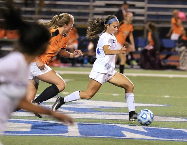 Carson's Bella Wakeling gets ahead of the Douglas defenders during Tuesday night's game.