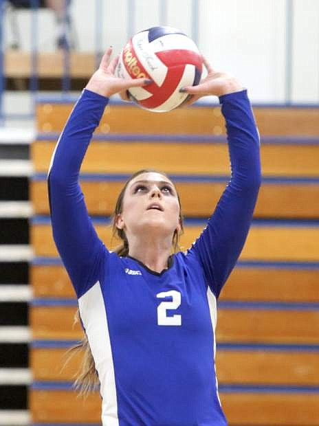 Natalie Anderson sets the ball in a game against Douglas on Tuesday night.
