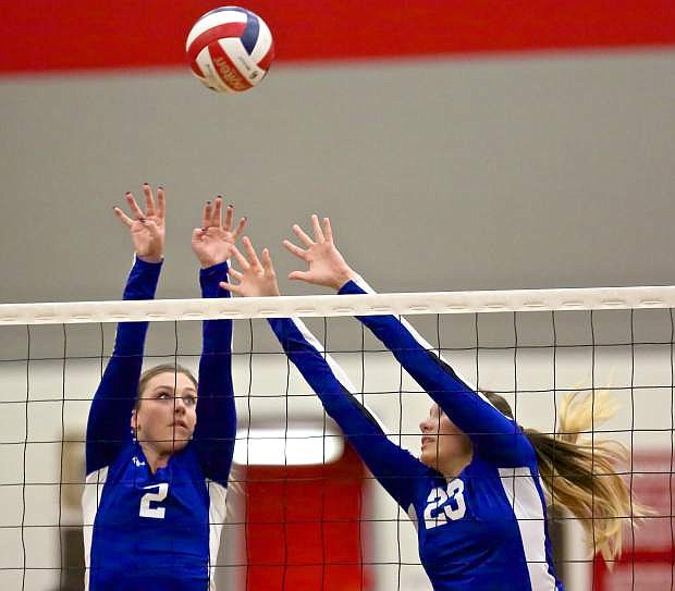 Natalie Anderson (2) and Ku'ulei Haupu (23) go up for a block against Wooster Thursday night in Reno.